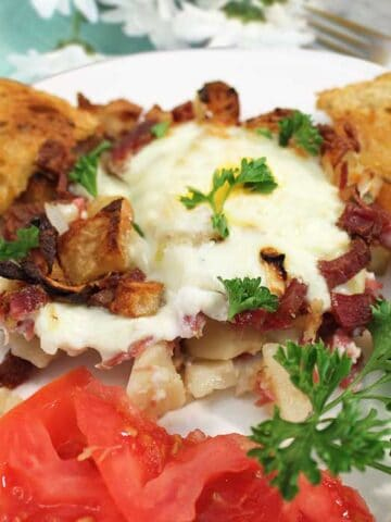 Corned Beef Hash on white plate closeup square