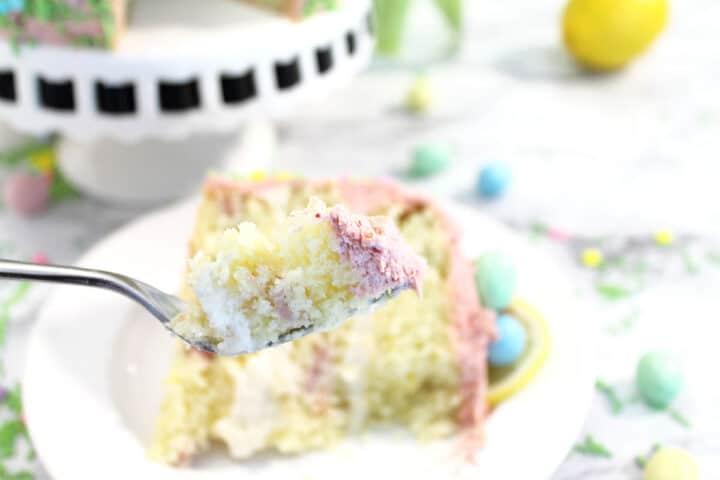 A bite of strawberry lemon cake on a fork.