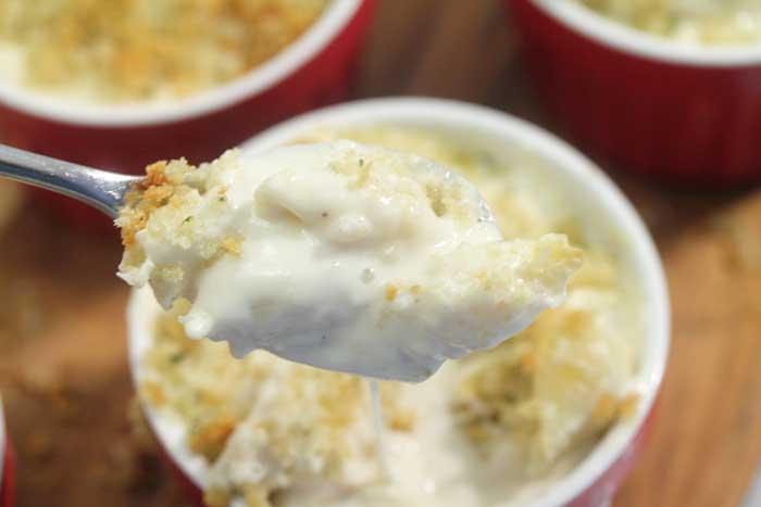 spoonful closeup of Baked Mac and Cheese in ramekin