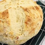 Closeup of cooling soda bread on wire rack.
