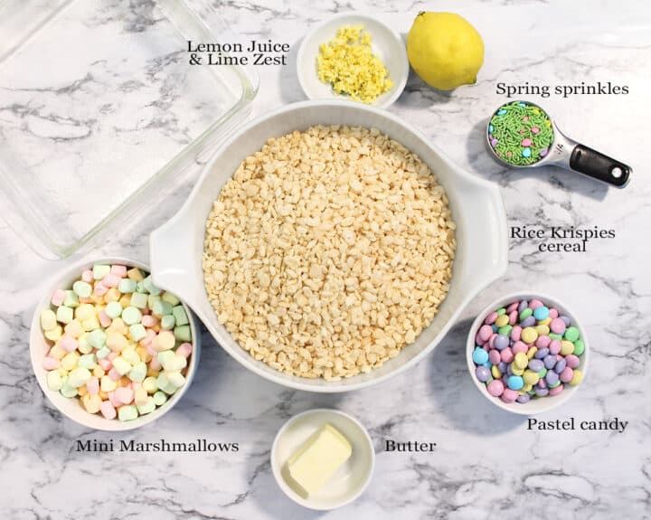 Ingredients for Easter Rice Krispie Treats on white marble.