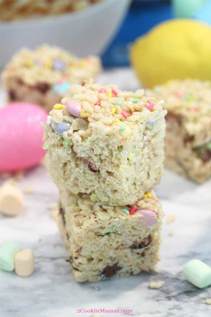 Easter Lemonade Rice Krispies Treats stacked | 2 Cookin Mamas These sweet, crispy Lemonade Rice Krispies Treats are the same classic favorite kids love but with a lemonade twist. They're thick, gooey and chewy, just what you want from your Rice Krispies Treats, and oh so easy to make. Add in some Easter sprinkles and candy and you have the perfect holiday snack. #snack #kids #ricekrispies #easy #marshmallows #sprinkles #lemonade #Easter #recipe #withM&Ms
