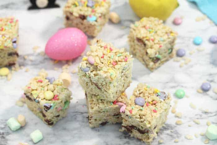 Lemonade Rice Krispies Treats on table with candies and marshmallows wide