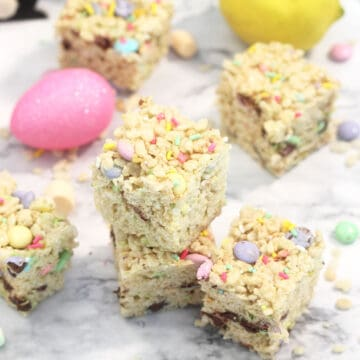 Wider view of stacked treats with candy and marshmallows around them.