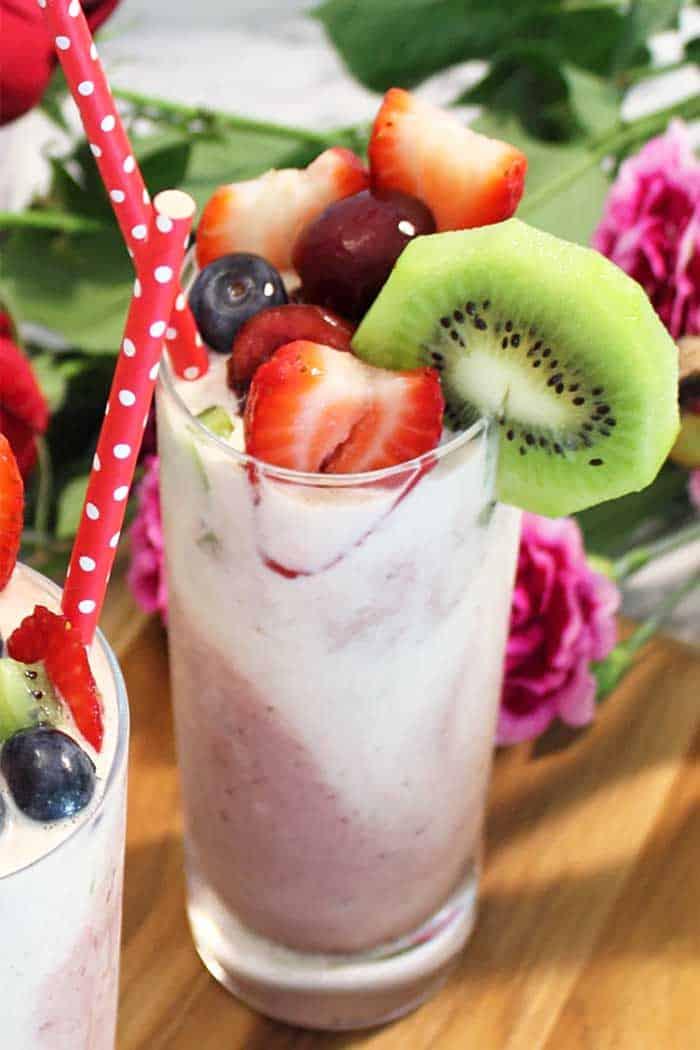 Cherry Vanilla Smoothie single with red polka dot straw and kiwi garnish