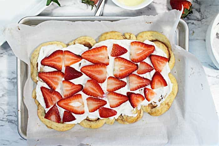 placing strawberiies on filling