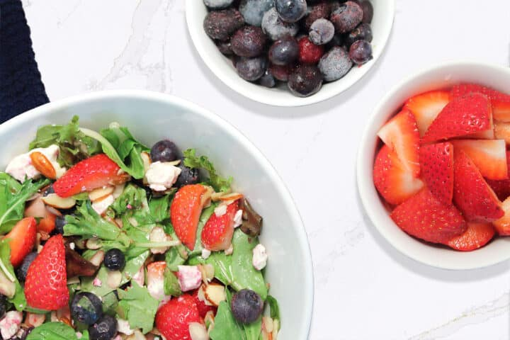 Overhead of Strawberry Blueberry Salad with berries beside it.