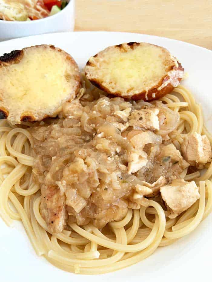 Plated French Onion Chicken on pasta.