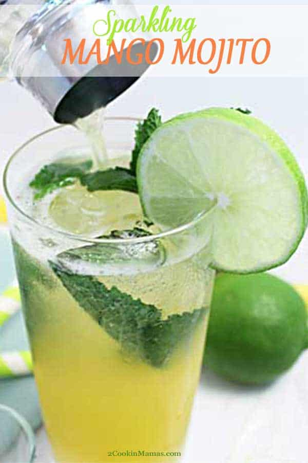 This Sparkling Mango Mojito is a fruity take on a mojito. Traditional tequila, lime and mint leaves are sweetened with mango juice & livened up with sparkling water. A tasty, agave drink that will tickle your taste buds. #cocktail #drink #tequila #mango #lime #recipe #sparklingwater #summer