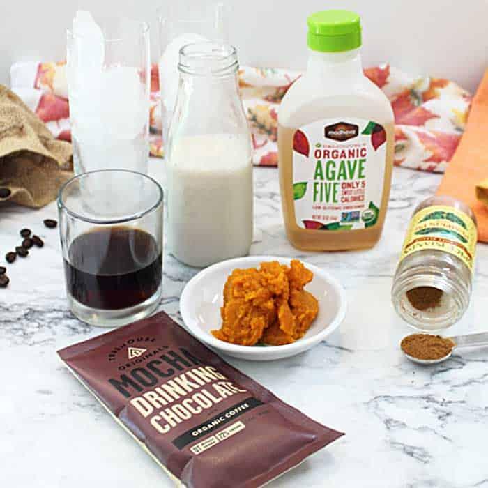 Ingredients to make pumpkin spice latte.
