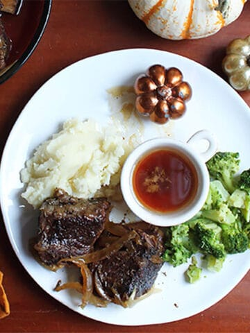 Beef Short Ribs dinner plated on white plate square.