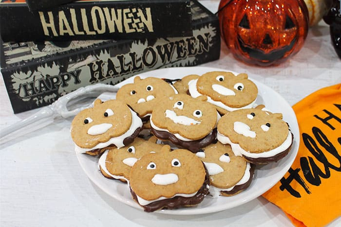 Plateful of smores cookies with Halloween towel.
