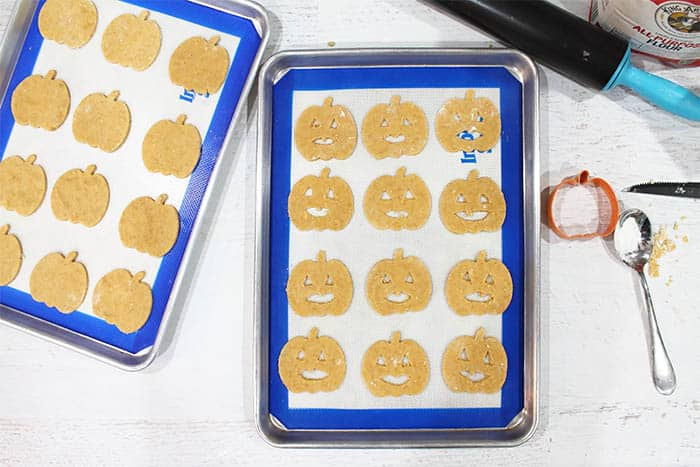 Cut out cookies, half with faces ready for oven.