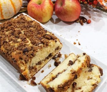 Sliced cinnamon Apple Bread on white plate showing streusel filling.