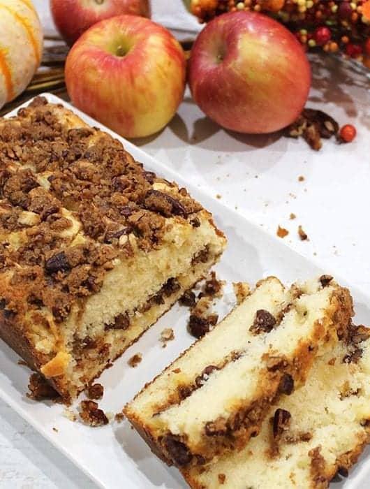 Sliced cinnamon Apple Bread on white plate showing streusel filling.
