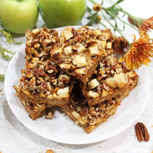 Magic Bars on white plate with apples square.