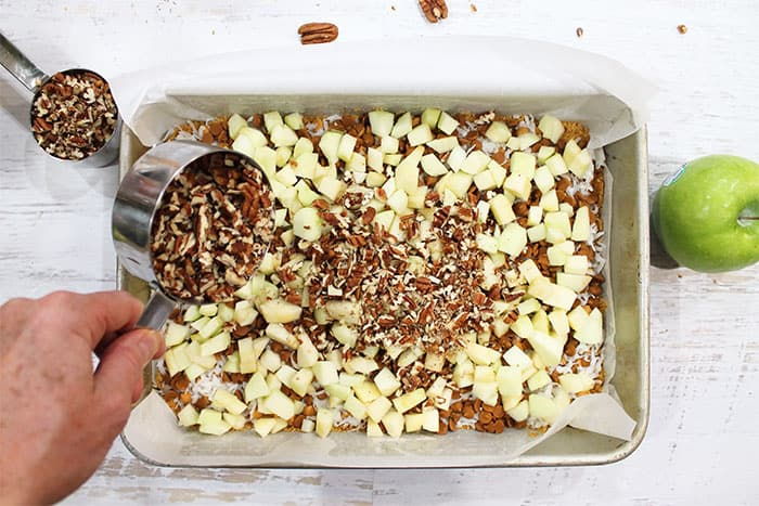 Layer with chopped apples then sprinkle with nuts.