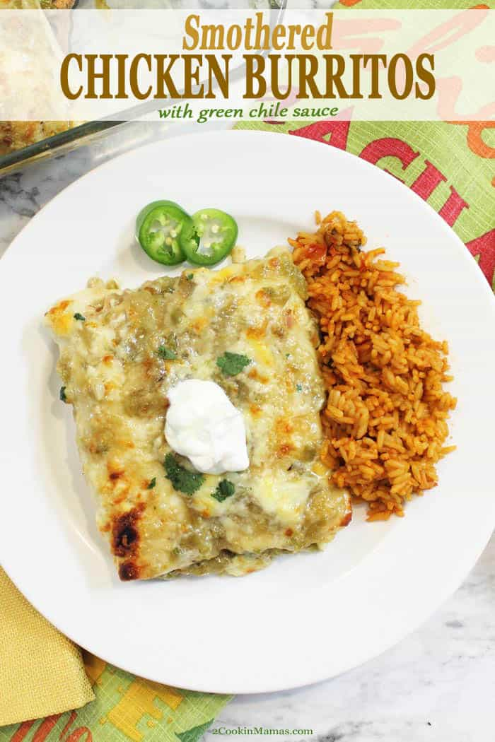 These easy, baked, smothered chicken burritos are a comfort food dream.  A flavor-packed dinner filled with seasoned rotisserie chicken, refried beans, eooey gooey cheese smothered in plenty of green chile enchilada sauce. It\'s a delicious way to satisfy your craving for Mexican food. Believe me, you need to make this ASAP! #burritos #greenchile #hatchchiles #dinner #comfortfood #recipe #rotisserie #mexican #smothered #baked #enchiladastyle #spicy #oven
