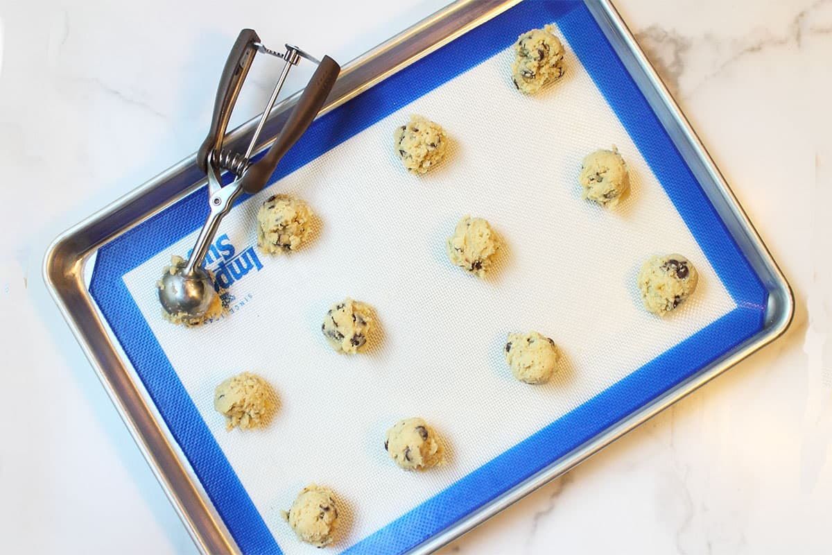 Scooping cookie dough onto cookie sheet.