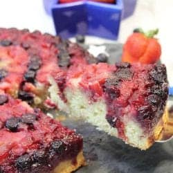 Closeup of slice on server with star filled with strawberries in back.