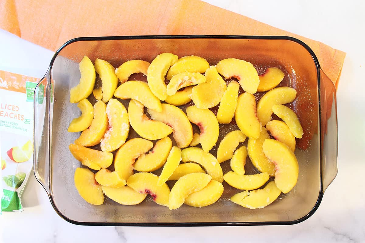 Step 1 Placing peaches in bottom of baking dish.