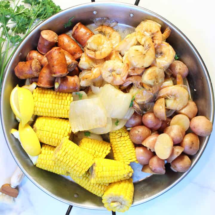 Overhead showing each ingredient in large pot.