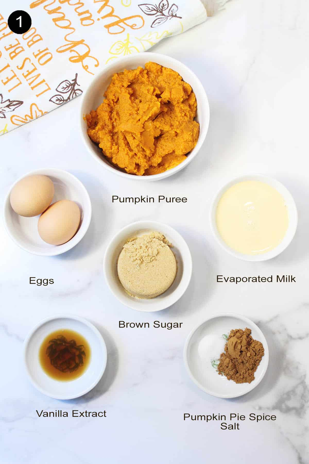 Ingredients for pumpkin filling on white table.