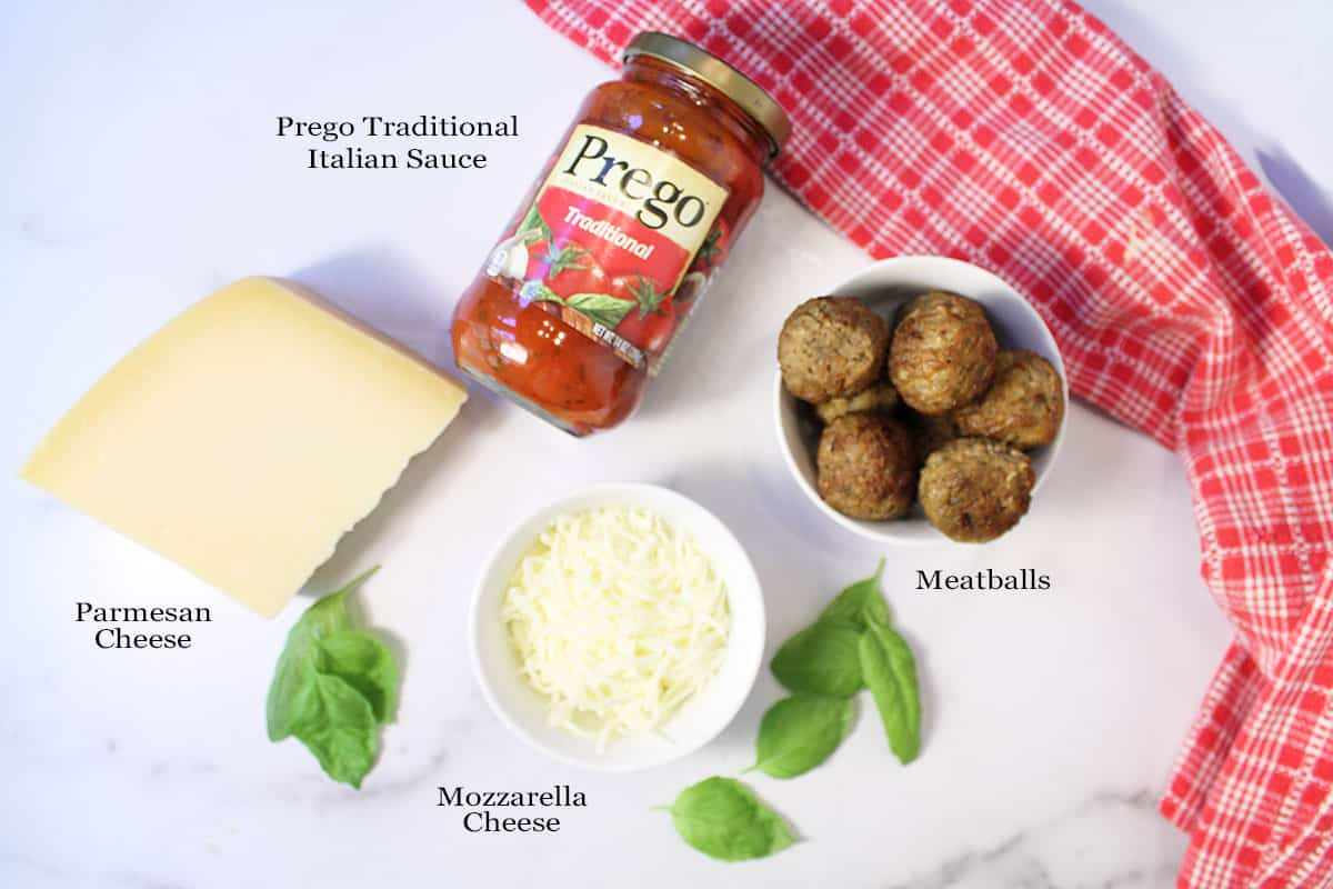 Meatball Tacos ingredients on white table labeled.