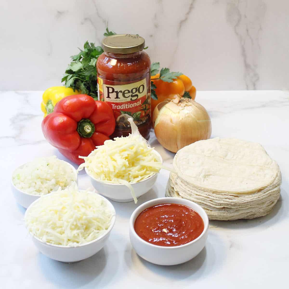 Ingredients for Turkey Frito Pie on white table.