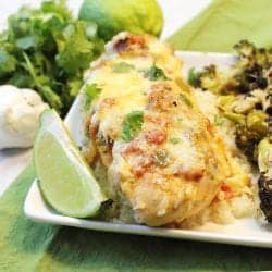 Dinner on white plate on top of green napkin.