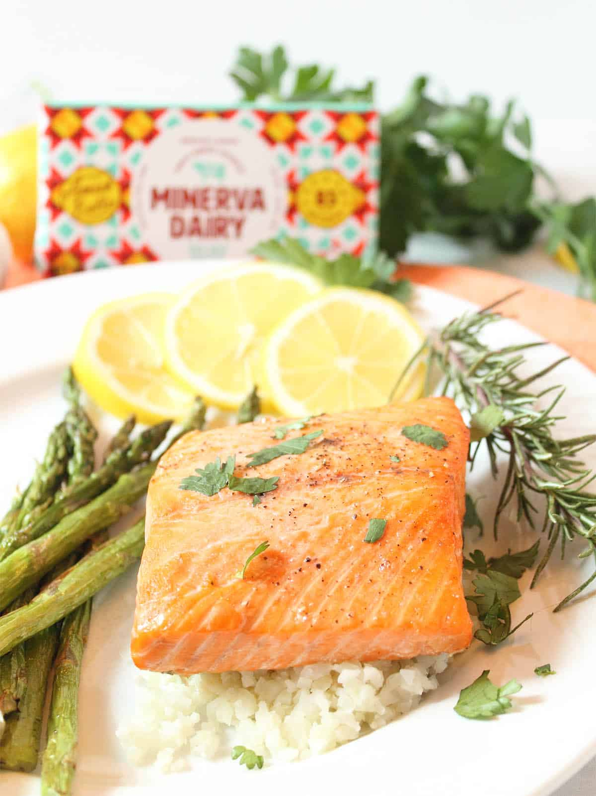 Salmon and asparagus dinner plated with Minerva butter package.