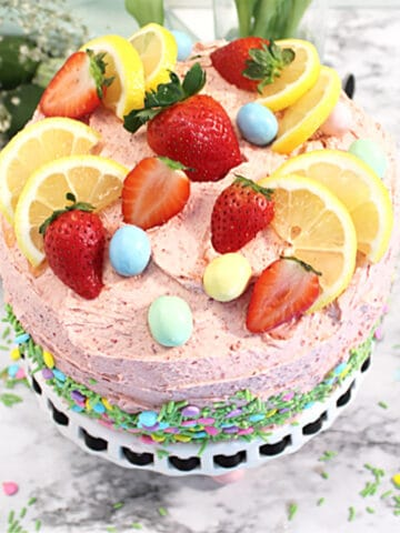 Overhead showing fruit decoration on top of lemon and strawberry cake.