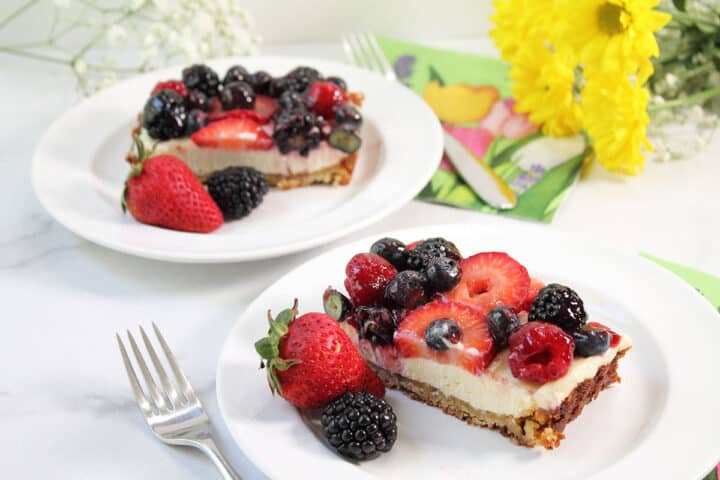 Two servings on white plates with fruit.