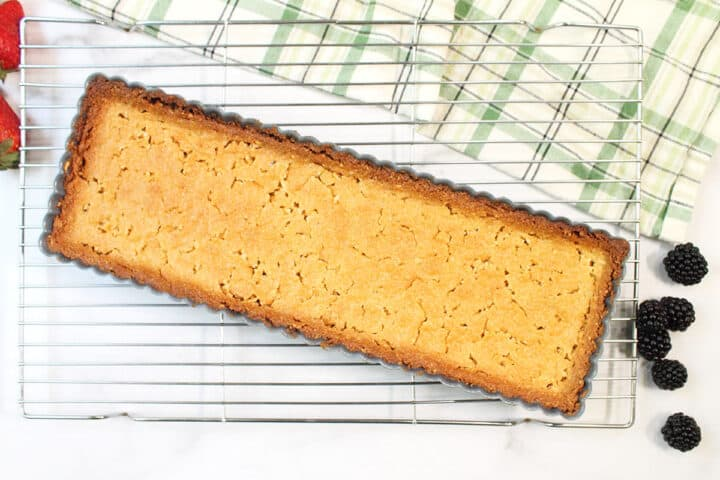 Baked almond crust on wire rack.