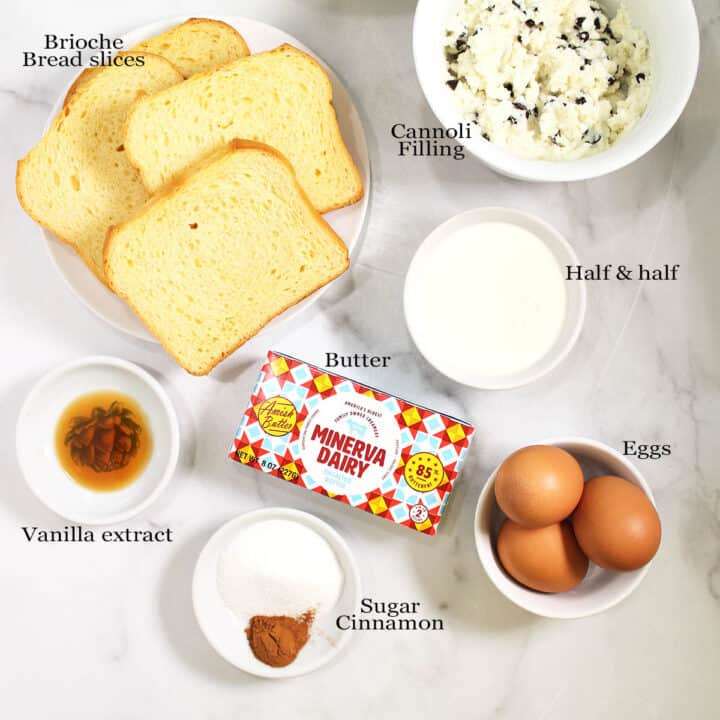 French toast ingredients laid out on marble table.