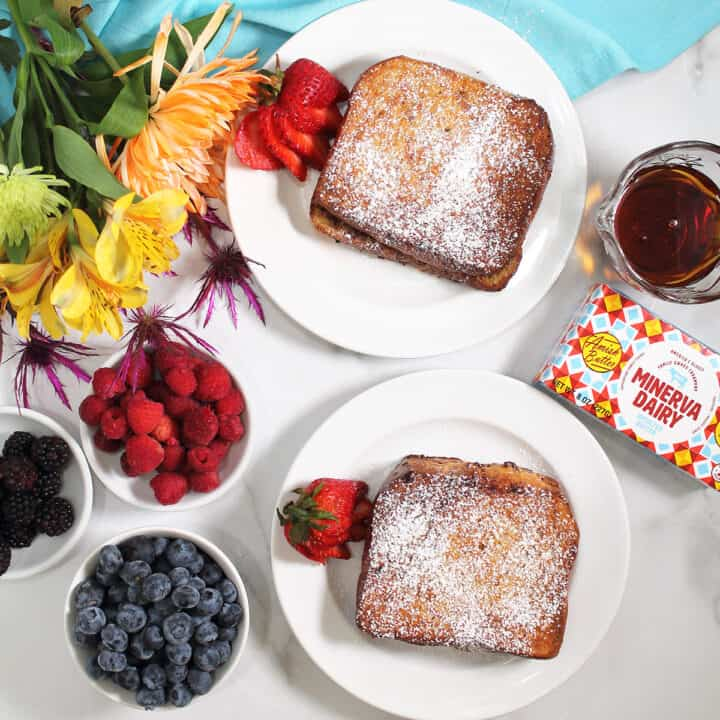 Overhead of French Toast with Minerva butter and berries on side.