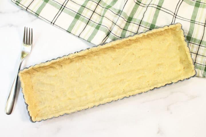 Press crust dough into tart pan.