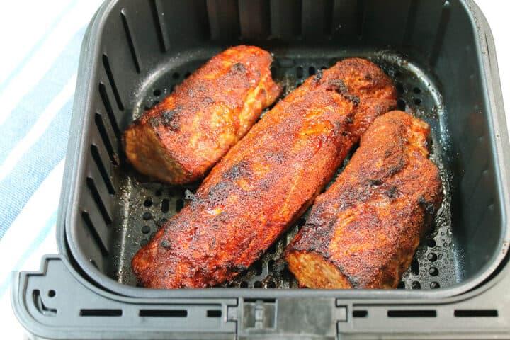 Closeup of cooked tenderloin in air fryer.