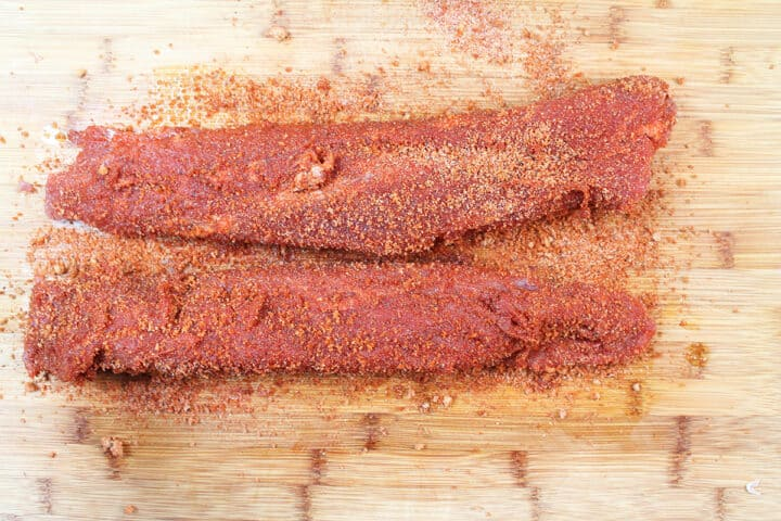 Cover the tenderloins with the rub and pat into meat.