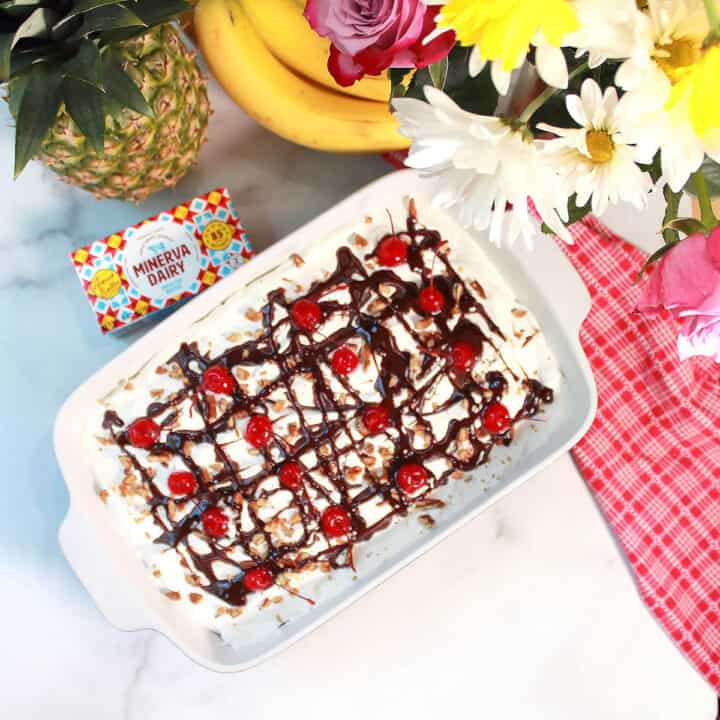 Overhead of finished banana split dessert with flowers.