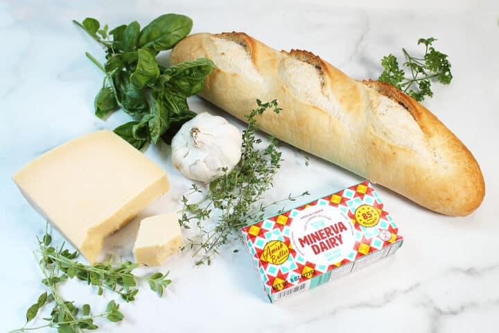 Air Fryer Garlic Bread ingredients on white table.