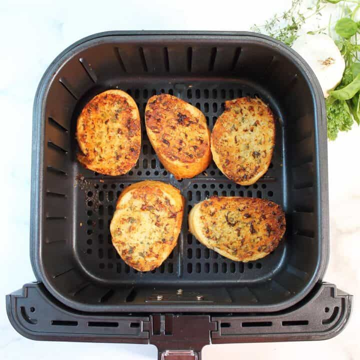 Finished air fried garlic bread in air fryer.