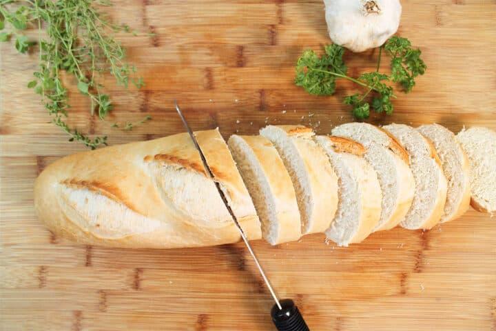 Slicing bread on cutting board.