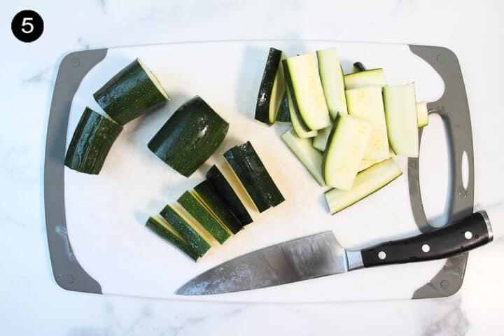 Cutting zucchini into fries.